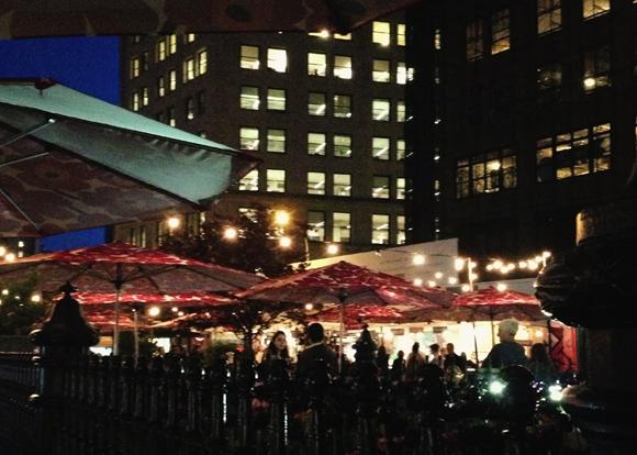 diners under marimekko umbrellas at mad sq eats
