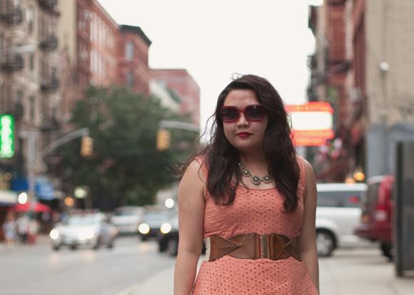 blogger in a forever 21 peach eyelet peplum dress