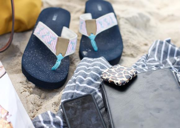 beach essentials j.crew flip flops and electronics