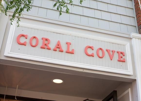 coral cove boutique sign