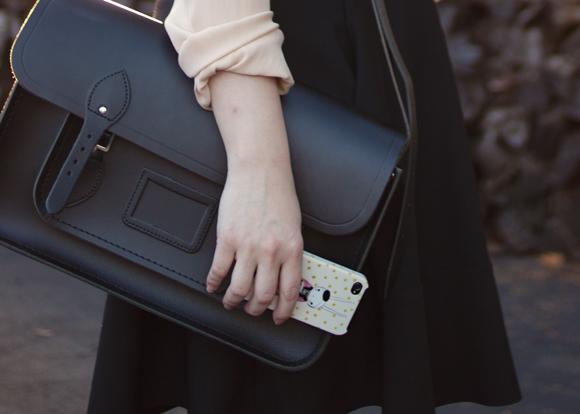 cambridge satchel in black and iconemesis fifi lapin iphone case