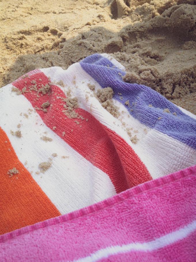 beach blanket with sand